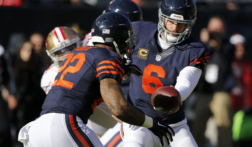 FILE- In this Dec. 6, 2015, file photo, Chicago Bears quarterback Jay Cutler (6) hands off the ball to running back Matt Forte (22) during the first half of an NFL football game against the San Francisco 49ers in Chicago. The Bears will face the Washington Redskins on Sunday, Dec. 13, 2015. (AP Photo/Charles Rex Arbogast, File)