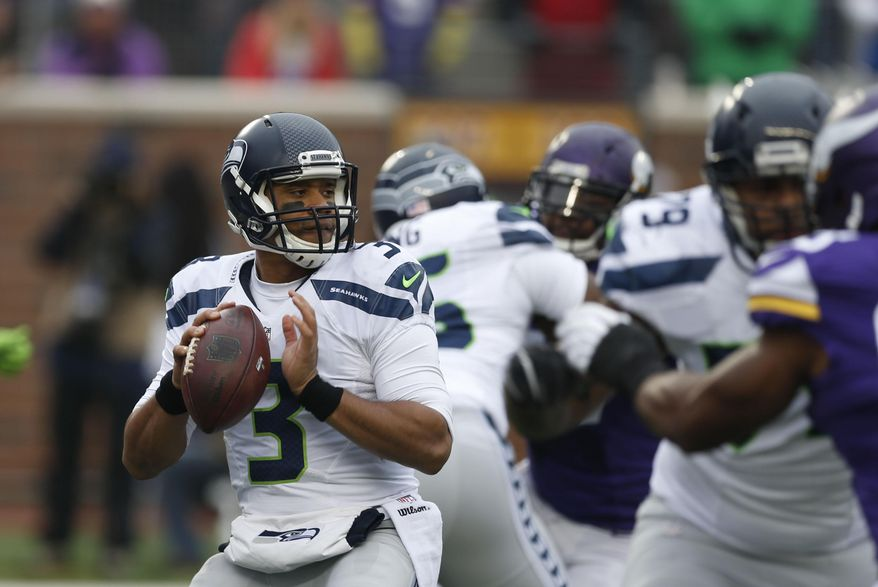 FILE - In this Sunday, Dec. 6, 2015 file photo, Seattle Seahawks quarterback Russell Wilson (3) looks to throw against the Minnesota Vikings in the first half of an NFL football game in Minneapolis. The Seattle Seahawks will play the Baltimore Ravens on Sunday, Dec. 13, 2015. (AP Photo/Jim Mone, File)