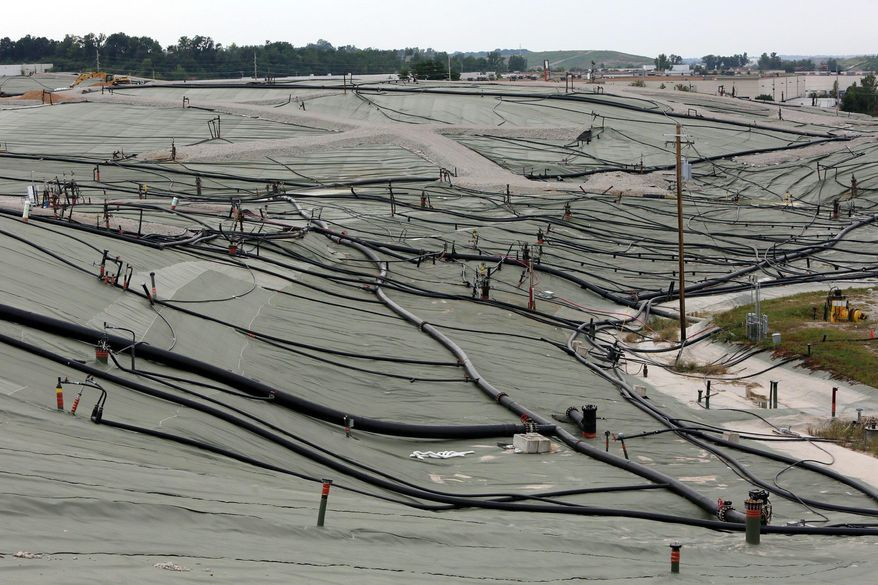 This photo taken Aug. 28, 2015 shows a membrane covering hundreds of feet of garbage and various pipes that direct leachate to a treatment plant at the Bridgeton Landfill in Bridgeton, Mo. The Environmental Protection Agency on Thursday, Dec. 10, 2015, ordered surface fire prevention measures at the St. Louis-area landfill where nuclear waste was illegally dumped four decades ago. (Huy Mach/The St. Louis Post Dispatch via AP)