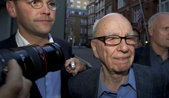 Chairman of News Corporation Rupert Murdoch (right) and his son James Murdoch, chief executive of News Corporation Europe and Asia, arrive at his residence in central London on July 10, 2011. (Associated Press) **FILE**