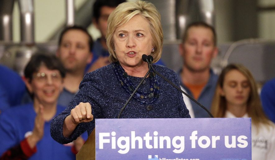 Democratic presidential candidate Hillary Clinton speaks to supporters during a campaign stop at a union hall on Friday, Dec. 11, 2015, in St. Louis. (AP Photo/Jeff Roberson)