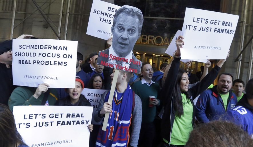 Fantasy sports fans demonstrate outside the Financial District offices of New York state Attorney General Eric Schneiderman on Nov. 13, 2015. Schneiderman ordered fantasy sports industry giants DraftKings and FanDuel to stop accepting play from New Yorkers, saying their business amounts to illegal gambling. Schneiderman maintains that New York law bans taking bets as a business, with exceptions for horse racing, casinos, state lotteries and certain other settings, but not daily fantasy sports sites. (Associated Press) **FILE**