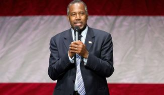 In this Dec. 8, 2015, photo, Republican presidential candidate Dr. Ben Carson speaks during a campaign event at Cobb Energy Center in Atlanta. Donald Trump and  Carson could dangle the possibility of independent runs for president well into the primary season next year, but they can't wait forever. State filing deadlines would give the two Republicans until about March 2016 to launch independent or third-party campaigns, experts said. That would give a well-financed campaign enough time to gather sufficient signatures on petitions so the candidate could appear on the ballot in every state.(AP Photo/David Goldman)