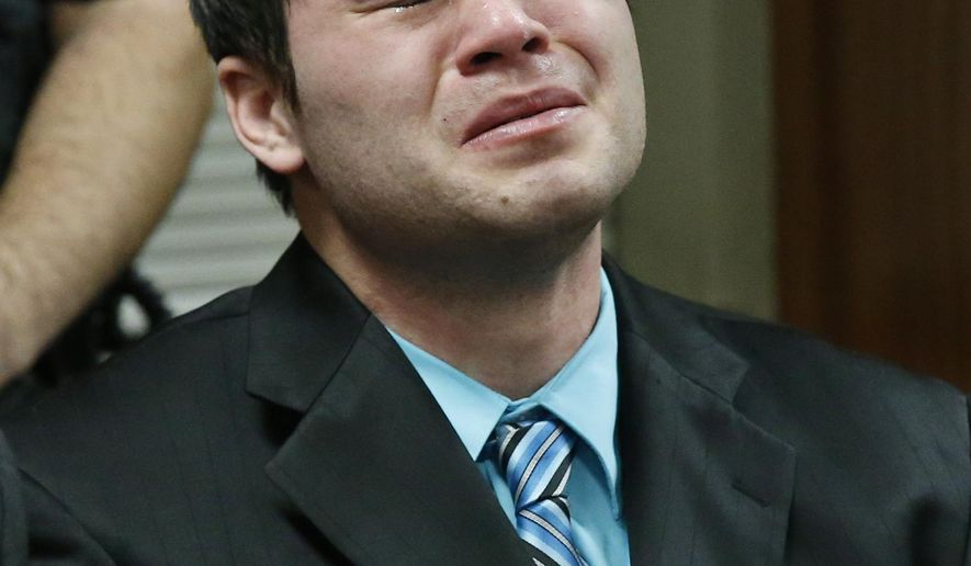 Daniel Holtzclaw cries as the verdicts are read in his trial in Oklahoma City, Thursday, Dec. 10, 2015. Holtzclaw, a former Oklahoma City police officer, was facing dozens of charges alleging he sexually assaulted several women while on duty. Holtzclaw was found guilty on a number of counts. (AP Photo/Sue Ogrocki, Pool)