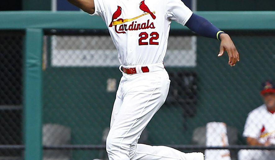 FILE - In this Sunday, July 26, 2015 file photo, St. Louis Cardinals right fielder Jason Heyward makes a leaping catch on a ball hit by Atlanta Braves' Nick Markakis during the ninth inning of a baseball game in St. Louis. A person familiar with the negotiations says the Chicago Cubs and free agent outfielder Jason Heyward have agreed to a $184 million, eight-year contract, Friday, Dec. 11, 2015. (AP Photo/Billy Hurst, File)