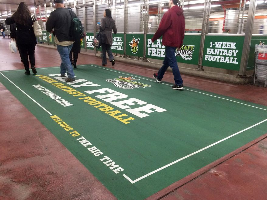 In this photo taken on Tuesday, Dec. 1, 2015, an ad for daily fantasy sports operator DraftKings is displayed in a subway station in Philadelphia. A state judge has barred daily fantasy sports sites DraftKings and FanDuel from doing business in New York.  The order issued Friday, Dec. 11, 2015, by state Supreme Court Justice Manuel Mendez also denied the country's two biggest daily fantasy sports sites' attempts to block the state's attorney general enforcement action. (AP Photo/Oskar Garcia)