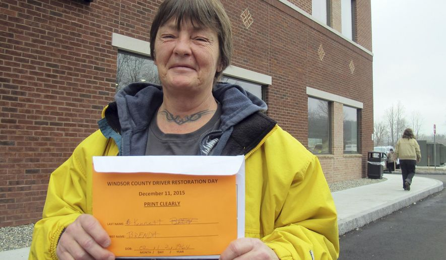 Brenda Kennett, of North Springfield, Vt. holds paperwork she received on Friday Dec. 11, 2015 in White River Junction, Vt., that will allow her to get her driver's license back. Hundreds of Vermont motorists whose drivers' licenses have been suspended were in White River Junction for the drivers' license restoration program that allows them to get their licenses back for a fraction of the amount they owe in fines and fees. The program is designed especially for low-income Vermonters who cannot afford the fines and end of breaking the law repeatedly. (AP Photo/Wilson Ring)