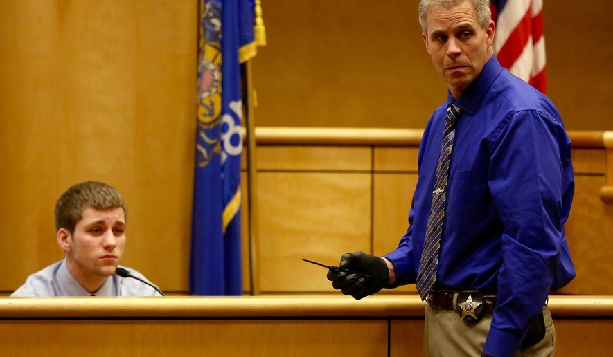 Investigator Rick Gearhart, the lead investigator with the Polk County sheriff's office shows the knife that Levi Acre-Kendall used to stab Peter Kelly as Acre-Kendall testifies in his trial Friday, Dec. 11, 2015, in Balsam Lake, Wis. Acre-Kendall is accused of fatally stabbing 34-year-old Peter Kelly of St. Croix Falls after an argument while fishing along the St. Croix River in April. (Leila Navidi/Star Tribune via AP)  MANDATORY CREDIT; ST. PAUL PIONEER PRESS OUT; MAGS OUT; TWIN CITIES LOCAL TELEVISION OUT