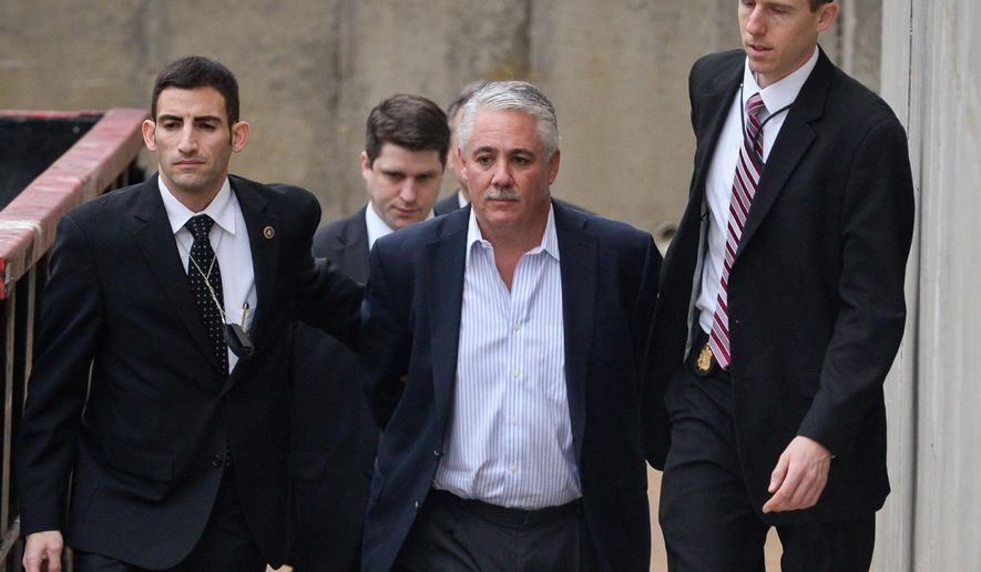 FILE - In this Dec. 9, 2015 file photo, former Suffolk County Police Chief James Burke  is escorted to a vehicle by FBI personnel outside an FBI office in Melville, N.Y.  On Friday, Dec. 11, 2015 a judge denied bail for Burke, charged with beating a man who stole sex toys, pornography and other items from his SUV. The chief, who ran one of the country's largest local law enforcement agencies, is accused of coercing officers under his command to lie about the beating.  (Steve Pfost/Newsday via AP, File)  NYC LOCALS OUT; MANDATORY CREDIT