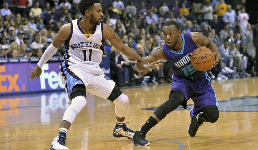 Charlotte Hornets guard Kemba Walker (15) controls the ball against Memphis Grizzlies guard Mike Conley (11) in the first half of an NBA basketball game Friday, Dec. 11, 2015, in Memphis, Tenn. (AP Photo/Brandon Dill)