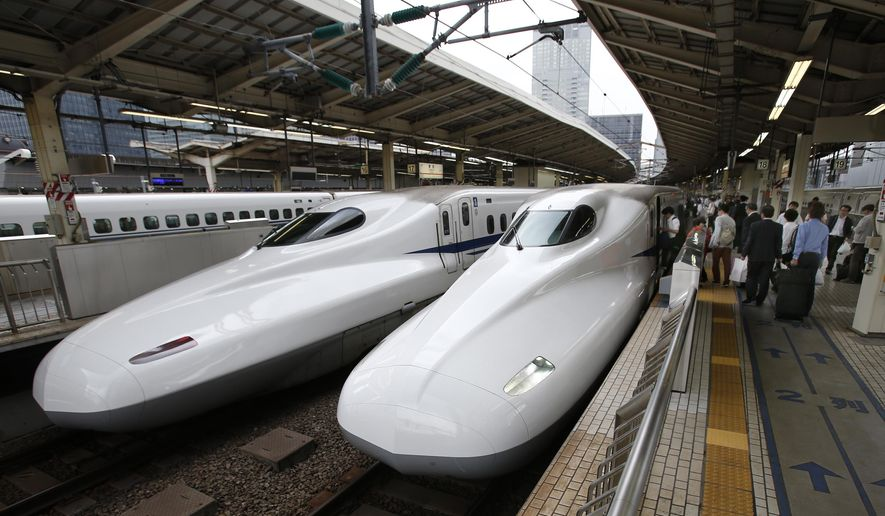 "FILE - In this Sept. 24, 2014 filephoto, passengers get on the Shinkansen high-speed train at Tokyo station in Tokyo. Indian Prime Minister Narendra Modi hopes the visit this weekend by Shinzo Abe, starting Friday, Dec. 11, 2015, will be a major step in transforming India into an economic powerhouse with Japan's help in building bullet trains, ""smart cities"" and accessing nuclear technology. India and Japan are set to sign a $15 billion agreement for a high-speed train linking the Indian financial hub of Mumbai with Ahmadabad, the commercial capital of Modi's home state, Gujarat. The train would cut travel time on the 505 kilometer (315 mile) route from eight hours to two. (AP Photo/Shizuo Kambayashi, File)"