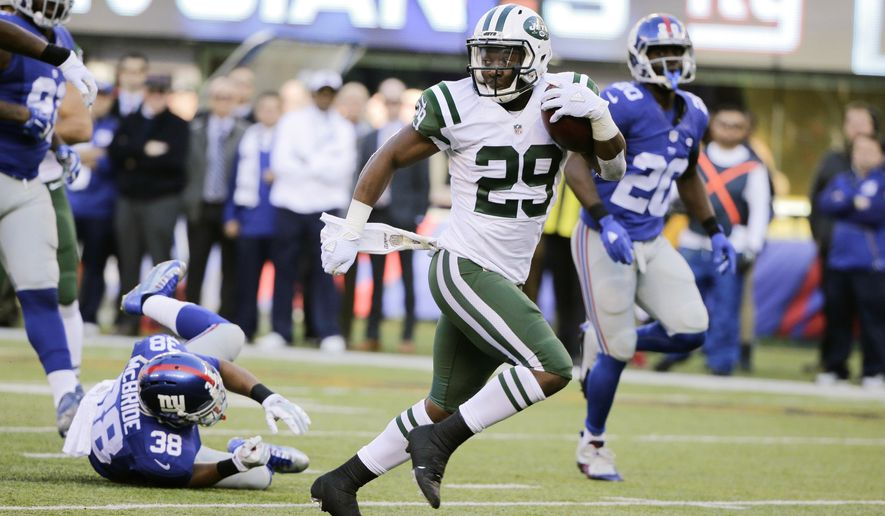 FILE - In this Dec. 6, 2015 file photo, New York Jets running back Bilal Powell (29) runs for a touchdown after catching a pass during the first half of an NFL football game against the New York Giants, in East Rutherford, N.J. Powell speaks barely above a whisper at times, as soft-spoken a player there might be in the NFL. It's not a knock on the New York Jets running back. He's just not the loud, look-at-me type. Powell is a humble, Christian guy who usually deflects attention from himself. So, when he celebrated his 25-yard touchdown catch against the Giants last Sunday by looking up to the sky with outstretched arms and briefly taking a knee in the end zone, it was a rare display of emotion for Powell.  (AP Photo/Julie Jacobson, File)