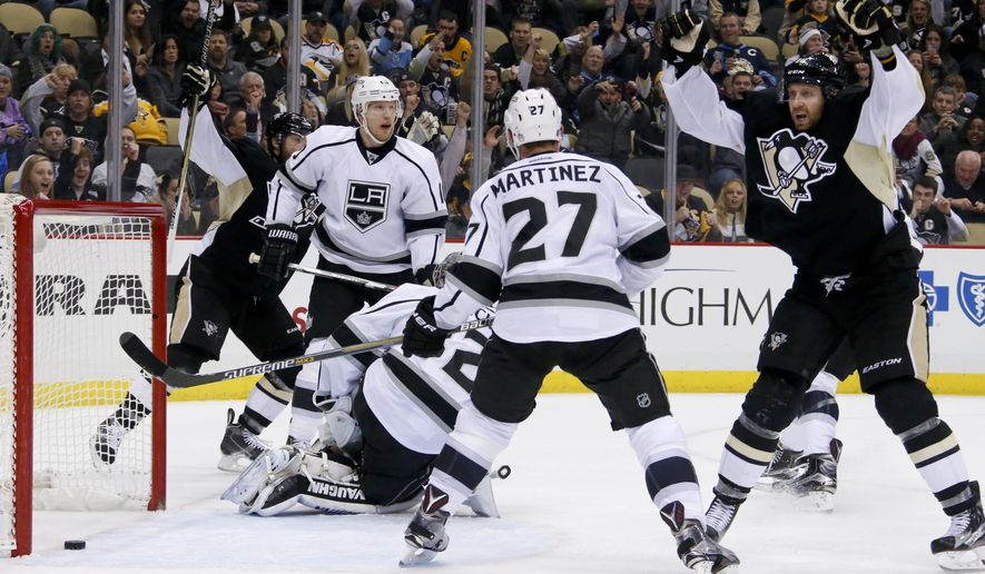 Pittsburgh Penguins' Eric Fehr, right, celebrates his goal past Los Angeles Kings goalie Jonathan Quick (32) during the second period of an NHL hockey game in Pittsburgh, Friday, Dec. 11, 2015. (AP Photo/Gene J. Puskar)