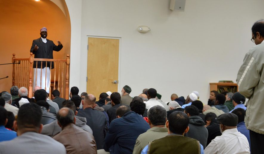"""Imam Shafi Abdul Aziz, left, of the the Islamic Center of New Mexico in Albuquerque, speaks on the importance of tolerance during afternoon prayer Friday, Dec. 11, 2015. A coalition of Christian and Jewish leaders presented the Albuquerque mosque dozens of """"letters of support"""" after GOP presidential hopeful Donald Trump suggested the U.S. place a moratorium on Muslim immigration. (AP Photo/Russell Contreras)"""