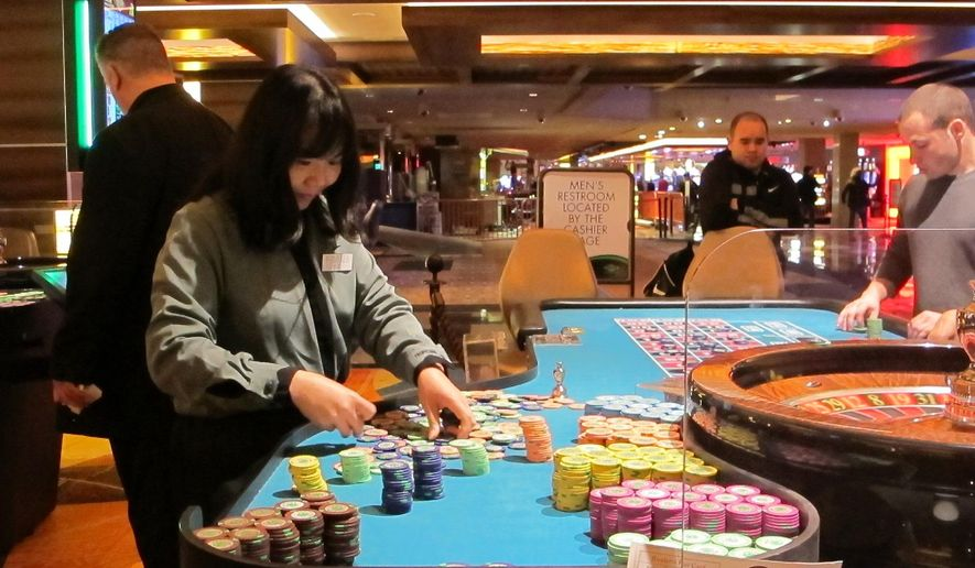 This April 17, 2015 photo shows a dealer counting chips during a game of roulette at the Tropicana Casino and Resort in Atlantic City, N.J. On Friday Dec. 11, 2015, New Jersey lawmakers said they will seek a statewide referendum in Nov. 2016 in which voters would be asked whether to approve two new casinos in the northern part of the state. Expanding casino gambling beyond Atlantic City requires amending the state Constitution. (AP Photo/Wayne Parry)
