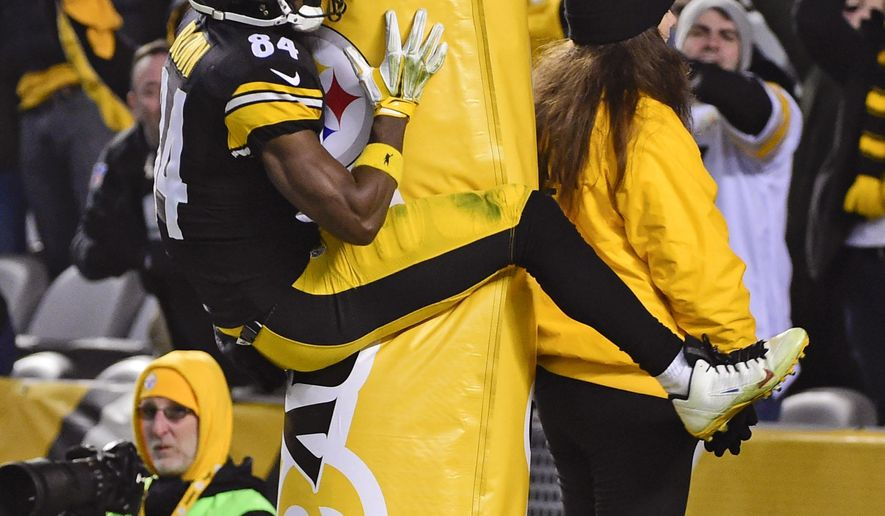 FILE - In this Sunday, Dec. 6, 2015 file photo, Pittsburgh Steelers wide receiver Antonio Brown (84) leaps into the goal post after scoring a touchdown during the second half of an NFL football game against the Indianapolis Colts in Pittsburgh. The Steelers won 45-10. Pittsburgh Steelers wide receiver Antonio Brown has been fined $11,576 by the NFL for jumping on the goal post to celebrate a touchdown, Friday, Dec. 11, 2015. (AP Photo/Fred Vuich, File)