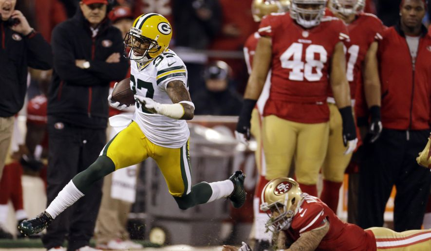 FILE - In this Jan. 12, 2013 file photo, Green Bay Packers cornerback Sam Shields (37) returns an interception for a touchdown as he dives past San Francisco 49ers quarterback Colin Kaepernick (7) during the first quarter of an NFC divisional playoff NFL football game in San Francisco. He's not quite a shutdown cornerback, though the Packers' Shields relishes opportunities to face top receivers. There's another one coming his way on Sunday, Dec. 13, 2015, in Dallas' Dez Bryant. (AP Photo/Ben Margot, File)