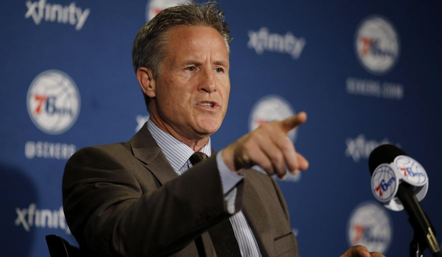 Philadelphia 76ers head coach Brett Brown speaks at a news conference before an NBA basketball game against the Detroit Pistons, Friday, Dec. 11, 2015, in Philadelphia. (AP Photo/Matt Slocum)