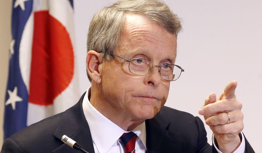 In this Monday, Nov. 25, 2013 file photo, Ohio Attorney General Mike DeWine answers questions during a news conference in Steubenville, Ohio. Attorney General Mike DeWine on Friday, Dec. 11, 2015, criticized the agency for disposing of fetal remains in landfills. (AP Photo/Keith Srakocic/File)