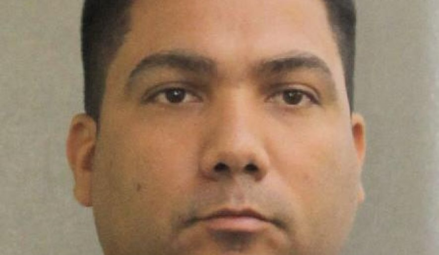 In this photo provided by the Broward County Sheriff's Office is Broward sheriff's deputy Peter Peraza, who has been charged with manslaughter in the 2013 shooting death of 33-year-old Jermaine McBean, who was carrying only an air rifle and may have been unable to hear police commands because he was listening to music through earbuds. (Broward Sheriff's Office via AP)