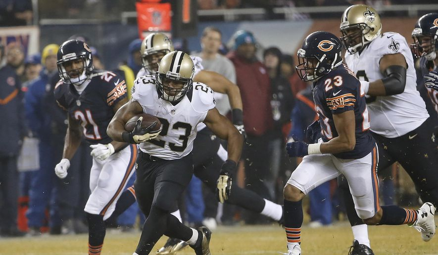 In this photo taken Dec. 15, 2014, then-New Orleans Saints running back Pierre Thomas (23) runs against the Chicago Bears during the first half of an NFL football game in Chicago. Thomas has signed with the Washington Redskins, whose ground game has been unproductive most of the season. (AP Photo/Charles Rex Arbogast)