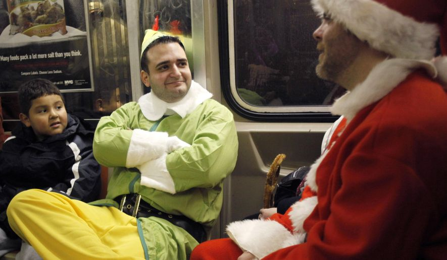 In this Dec. 11, 2010 photo, John Paul, center, dressed as an elf and Michael Smallwood, in a Santa Claus outfit, ride the E train in New York. Paul and Smallwood were participants in SantaCon, an annual holiday pub crawl during which participants dress up as Santa Claus or wear Christmas-themed clothing. As thousands of Santa-suited merrymakers prepare to hit the city's streets and bars Saturday, Dec. 12, 2015, organizers say they're taking steps to deter naughty behavior. (AP Photo/Mary Altaffer/ File)