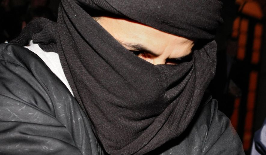 "FILE - In this Monday, March, 15, 2010 file photo, Ali Charaf Damache arrives at the courthouse in Waterford Ireland. An Algerian-Irish man accused of recruiting an American woman who called herself ""Jihad Jane"" and plotting to kill a Swedish artist has been arrested in Spain, officials said Friday, Dec. 11, 2015. Ali Charaf Damache was arrested Thursday, Dec. 10 in Barcelona based on a U.S. warrant issued stating he was a suspected recruiter for an Islamic extremist group, according to the Interior Department for the northeastern region of Catalonia. (AP Photo/Peter Morrison, File)"