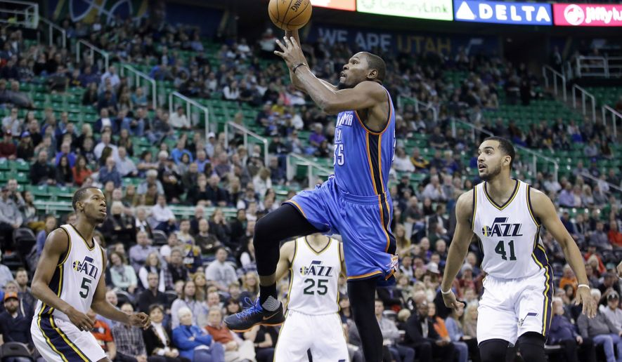 Oklahoma City Thunder forward Kevin Durant (35) goes to the basket as Utah Jazz's Rodney Hood (5), Raul Neto (25) and Trey Lyles (41) look on during the first quarter of an NBA basketball game Friday, Dec. 11, 2015, in Salt Lake City. (AP Photo/Rick Bowmer)
