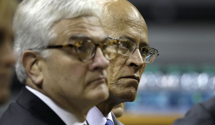 """In this Nov. 16, 2015 photo, University of Missouri-Columbia Chancellor Hank Foley, left, sits alongside  University of Missouri system President Mike Middleton during a press conference announcing the retirement of head football coach Gary Pinkel in Columbia, Mo. Middleton, during a Board of Curators meeting Friday, Dec. 11, 2015 in St. Louis, acknowledged """"significant challenges"""" in the wake of recent campus turmoil, but said he sees it as an opportunity for the system to become a national leader in addressing racial concerns. (AP Photo/Jeff Roberson)"""
