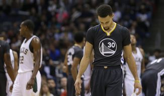 Golden State Warriors' Stephen Curry looks down during the second half of an NBA basketball game against the Milwaukee Bucks Saturday, Dec. 12, 2015, in Milwaukee. The Bucks won 108-95. (AP Photo/Aaron Gash)
