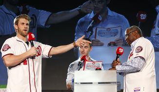 """Washington Nationals right fielder Bryce Harper, left, and manager Dusty Baker, right, play a game of """"Old School vs. New School,"""" with MASN's Dan Kolko, center, during the team's """"Winterfest"""" baseball fan festival Saturday, Dec. 12, 2015, in Washington. (AP Photo/Alex Brandon)"""