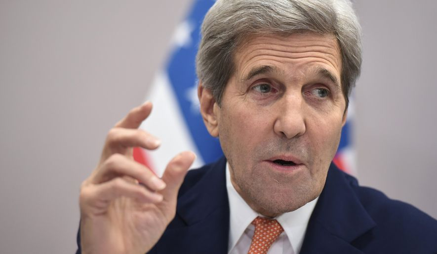 U.S. Secretary of State John Kerry speaks to the press following the COP21 United Nations conference on climate change in Le Bourget, France, Saturday, Dec. 12, 2015. (Mandel Ngan/Pool Photo via AP) ** FILE **