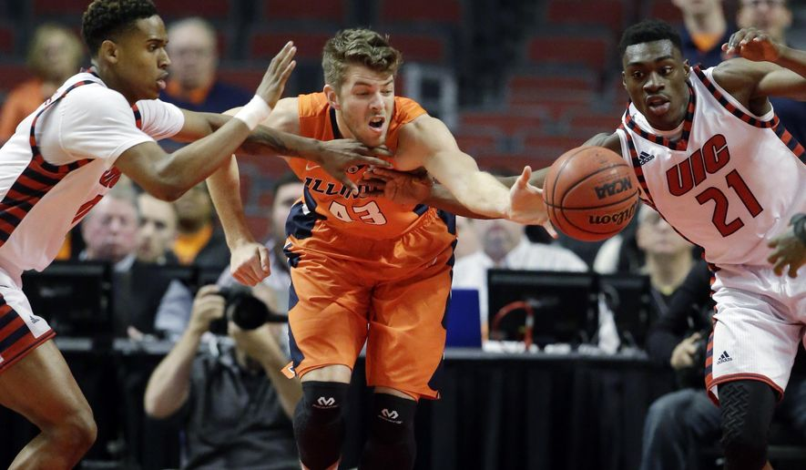 Illinois forward Michael Finke, center, battles for a loose ball against Illinois-Chicago guard Dominique Matthews, left, and forward Tai Odiase during the first half of an NCAA college basketball game on Saturday, Dec. 12, 2015, in Chicago. (AP Photo/Nam Y. Huh)