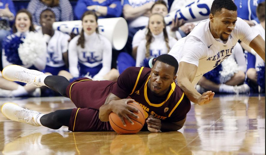Kentucky's Isaiah Briscoe, right, and Arizona State's Willie Atwood dive for a loose ball during the first half of an NCAA college basketball game Saturday, Dec. 12, 2015, in Lexington, Ky.  (AP Photo/James Crisp)