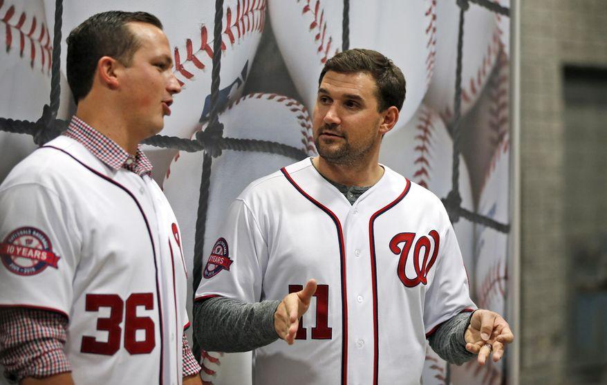 "Washington Nationals relief pitcher Sammy Solis, left, and first baseman Ryan Zimmerman talk between fan photos during the team's ""Winterfest"" baseball fan festival Saturday, Dec. 12, 2015, in Washington. (AP Photo/Alex Brandon)"