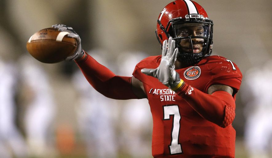 Jacksonville State quarterback Eli Jenkins (7) warms up before an NCAA college football game against Charleston Southern, Friday, Dec. 11, 2015, in Jacksonville, Ala. (AP Photo/ Butch Dill)