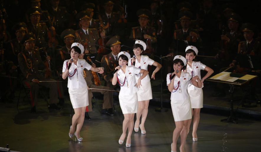 FILE - In this  Sunday, Oct. 11, 2015, file photo, members of North Korea's Moranbong band sing and dance during a joint performance with the State Merited Chorus in Pyongyang, North Korea. North Korea's Moranbong band, an all-female band formed by North Korean leader Kim Jong Un, has canceled its concerts in Beijing and abruptly left the Chinese capital for unknown reasons. (AP Photo/Charles Dharapak, File)