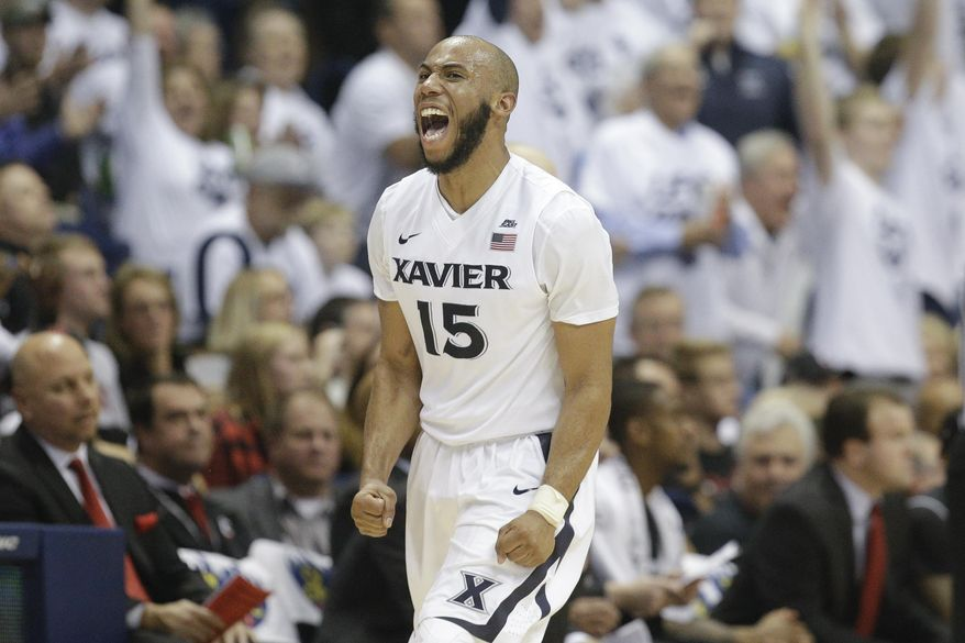 Xavier's Myles Davis celebrates after scoring in the final second of the first half of an NCAA college basketball game against Cincinnati, Saturday, Dec. 12, 2015, in Cincinnati. (AP Photo/John Minchillo)