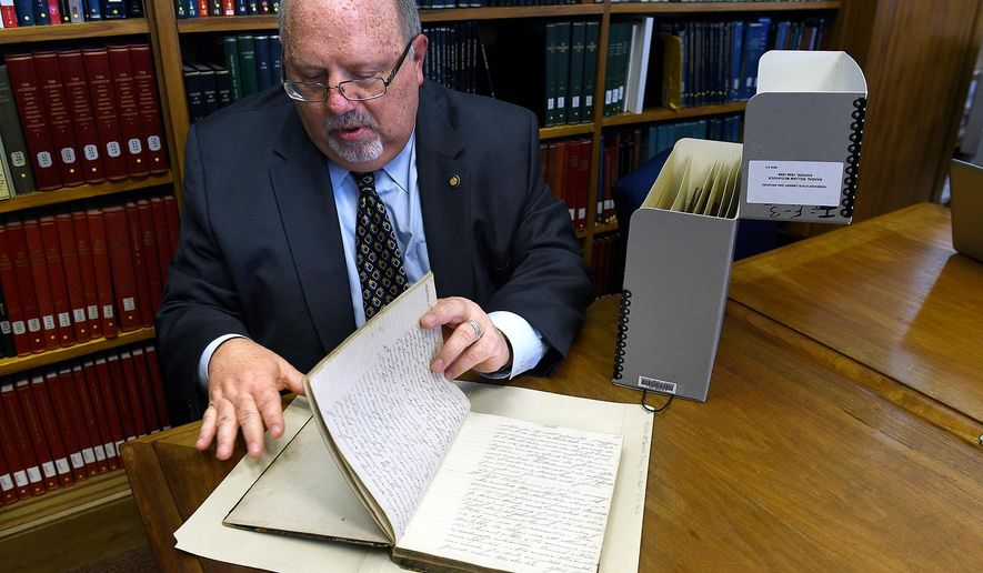 State Librarian and Archivist Chuck Sherrill holds a 1860s diary of Randal William McGavock at  Tennessee State Library and Archives on Tuesday Dec. 2, 2015 in Nashville.  The Civil War-era diary was recently found in California.  (Shelley Mays/The Tennessean via AP) NO SALES; MANDATORY CREDIT