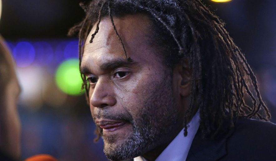 Former French international soccer player Christian Karembeu is interviewed as he arrives for the Euro 2016 soccer championships draw in Paris, Saturday, Dec. 12, 2015.  (AP Photo/Matt Dunham)