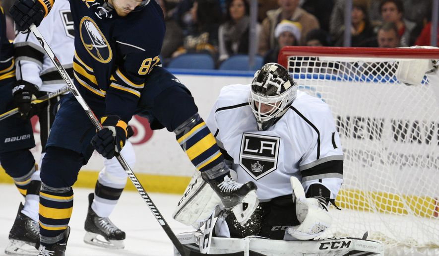Buffalo Sabres left winger Marcus Foligno (82) deflects the puck on Los Angeles Kings goaltender Jhonas Enroth (1), of Sweden, during the first period of an NHL hockey game, Saturday, Dec. 12, 2015, in Buffalo, N.Y. (AP Photo/Gary Wiepert)
