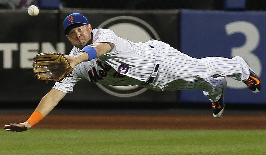 FILE - In this Sept. 16, 2015, file photo, New York Mets right fielder Michael Cuddyer makes a leaping catch of a line drive hit by Miami Marlins' Martin Prado during the first inning of a baseball game in New York. Cuddyer is ready to retire after playing 15 seasons in the major leagues. He turns 37 in March and  leaves with one season left on a two-year, $21 million contract that he signed with the Mets as a free agent.   (AP Photo/Kathy Willens, File)