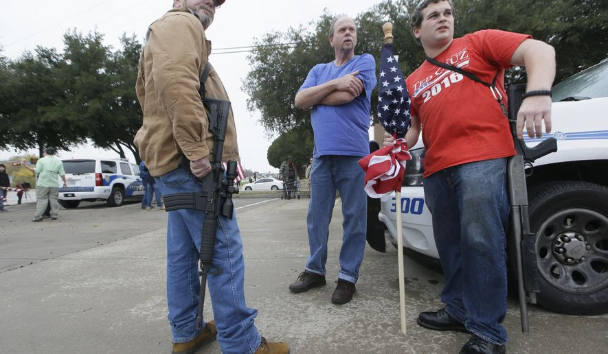 Armed anti-Muslim protestors, who did not want to give their names, prepare to take a position across the street from a mosque in Richardson, Texas on Saturday, Dec. 12, 2015. (AP Photo/LM Otero)