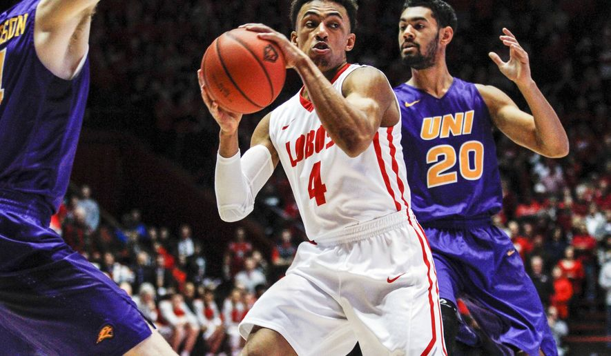 New Mexico's Elijah Brown (4) drives in the lane guarded by Northern Iowa's Jeremy Morgan (20) during the first half an NCAA college basketball game, Saturday, Dec. 12, 2015, in Albuquerque, N.M. (AP Photo/Juan Labreche)