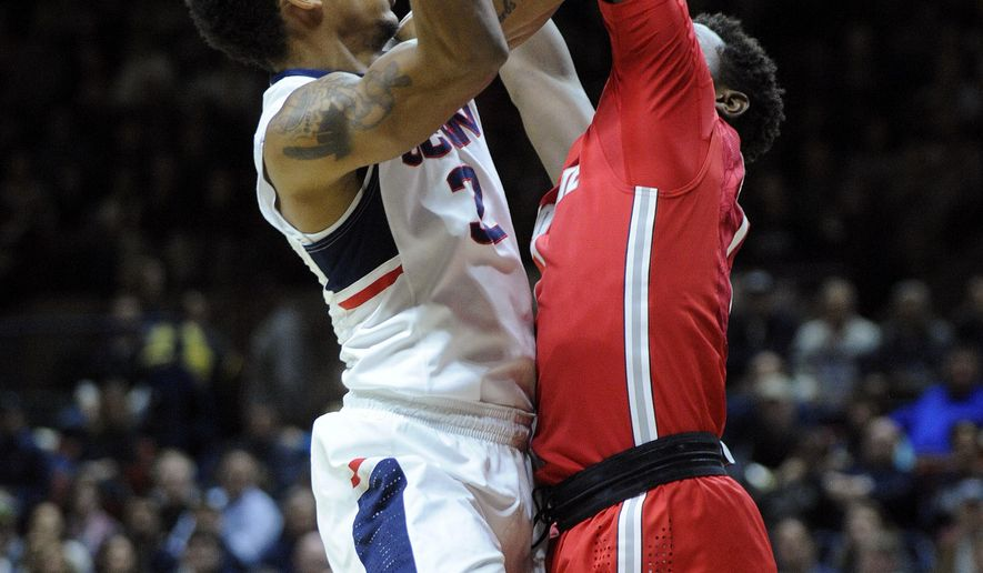 Connecticut's Jalen Adams (2) shoots over Ohio State's Jae'Sean Tate (1) during the first half of Connecticut's 75-55 victory in an NCAA college basketball game in Storrs, Conn., on Saturday, Dec. 12, 2015. (AP Photo/Fred Beckham)