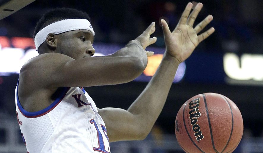 Kansas' Carlton Bragg Jr. dunks during the first half of an NCAA college basketball game against Oregon State Saturday, Dec. 12, 2015, at Sprint Center in Kansas City, Mo. (AP Photo/Charlie Riedel)