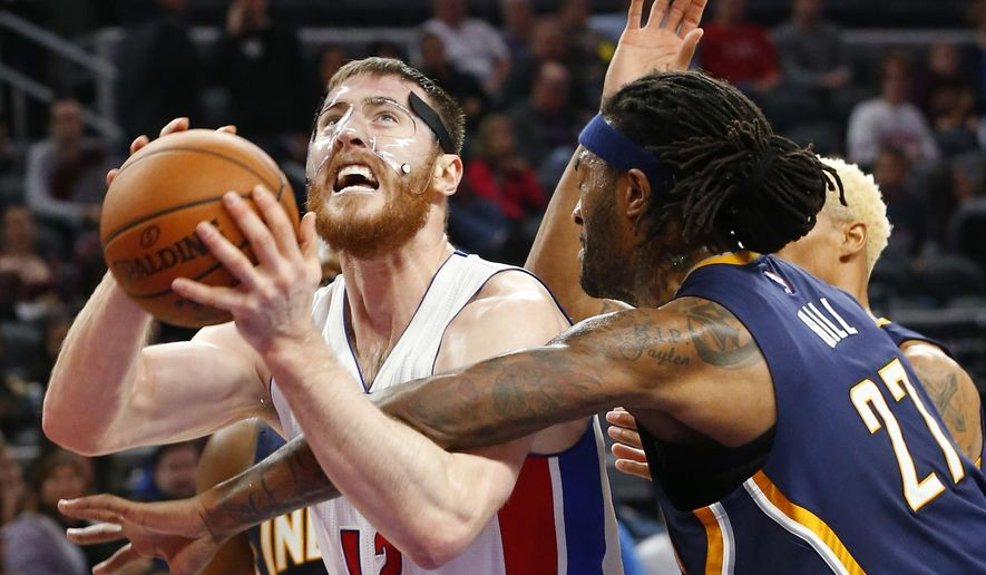 Detroit Pistons center Aron Baynes (12) is fouled by Indiana Pacers center Jordan Hill (27) in the second half of an NBA basketball game Saturday, Dec. 12, 2015 in Auburn Hills, Mich. (AP Photo/Paul Sancya)