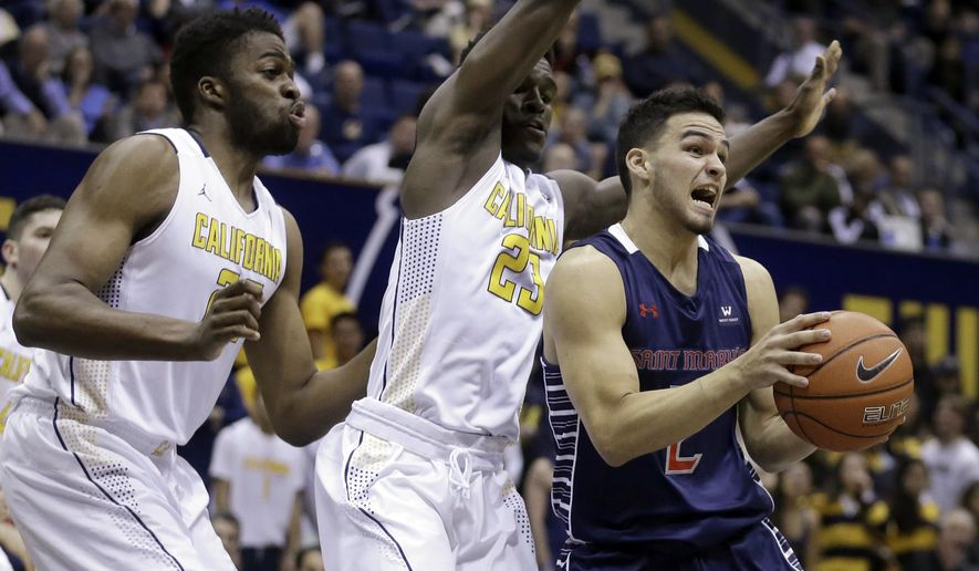 Saint Mary's Stefan Gonzalez, right, looks to pass away from California's Kingsley Okoroh, left, and Jabari Bird in the first half of an NCAA college basketball game Saturday, Dec. 12, 2015, in Berkeley, Calif. (AP Photo/Ben Margot)