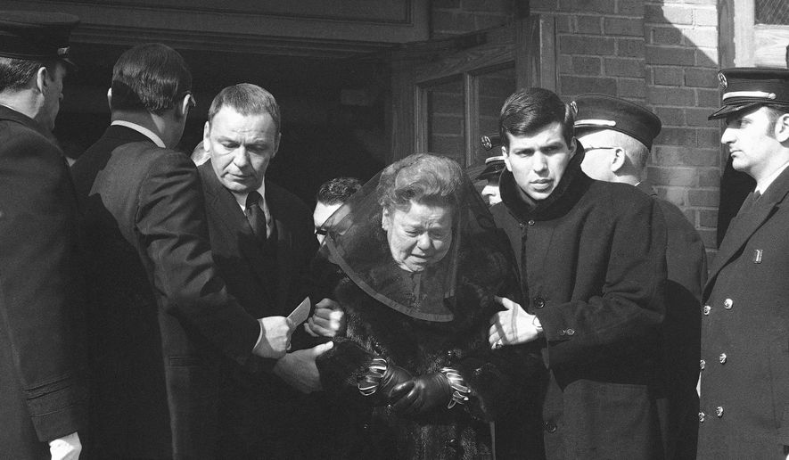 "FILE - In this Jan. 28, 1969, file photo, Frank Sinatra aids his mother as they leave the Madonna Church in Fort Lee, N. J., after a funeral service for the singer's father Anthony M. Sinatra. At right is Frank Sinatra Jr., also a singer. Frank Sinatra's father, Anthony was a boxer who fought in Irish gyms as ""Marty O'Brien, before becoming a firefighter and tavern owner. Frank Sinatra, who died in 1998, at 82, would have celebrated his 100th birthday on Dec. 12, 2015. (AP Photo/Anthony Camerano, File)"