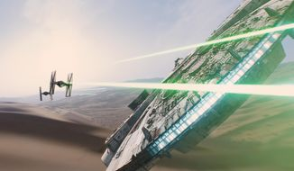 """This photo provided by Disney/Lucasfilm shows a scene from the new film, """"Star Wars: The Force Awakens."""" Here, imperial TIE Fighters (left) attack Han Solo's ship, the Millennium Falcon. The movie releases in U.S. theaters on Dec. 18, 2015. (Film Frame/Disney/Lucasfilm via AP)"""